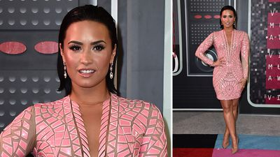 Demi Lovato was pretty in structured pink on the VMAs red carpet. (AAP)