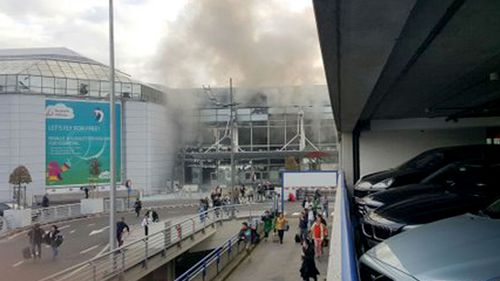 Smoke billows from Zaventem Airport in Brussels. (Supplied)