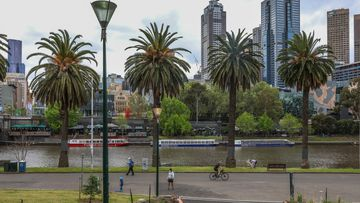 People along the banks of the Yarra River in Melbourne.