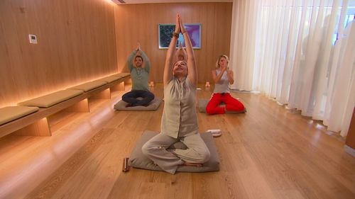 Stretching classes are offered to customers to help with the long flight. (9NEWS)