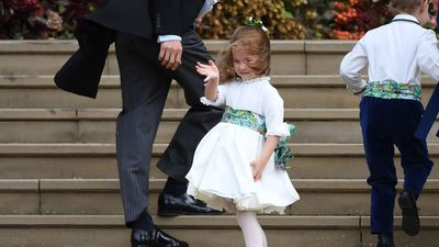 Prince Charlotte waves to the crowd at Princess Eugenie's wedding in October, 2018