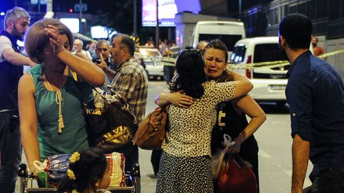 Survivors console each other outside Ataturk airport. (Getty)