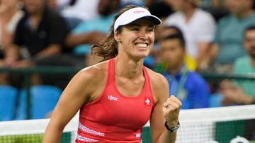 Martina Hingis of Switzerland celebrates winning against Daria Gavrilova and Samantha Stosur from Australia after the women's first round doubles match of the Rio 2016 Olympic Games Tennis events. (AAP)
