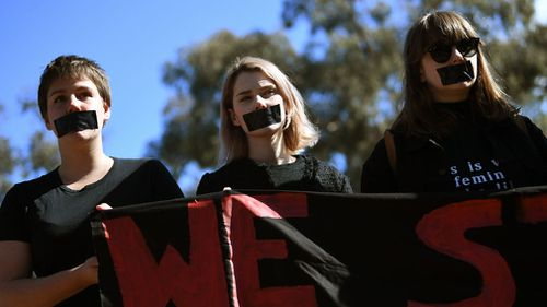 Students participate in a protest after the release of the national student survey on sexual assault and sexual harassment. (AAP)