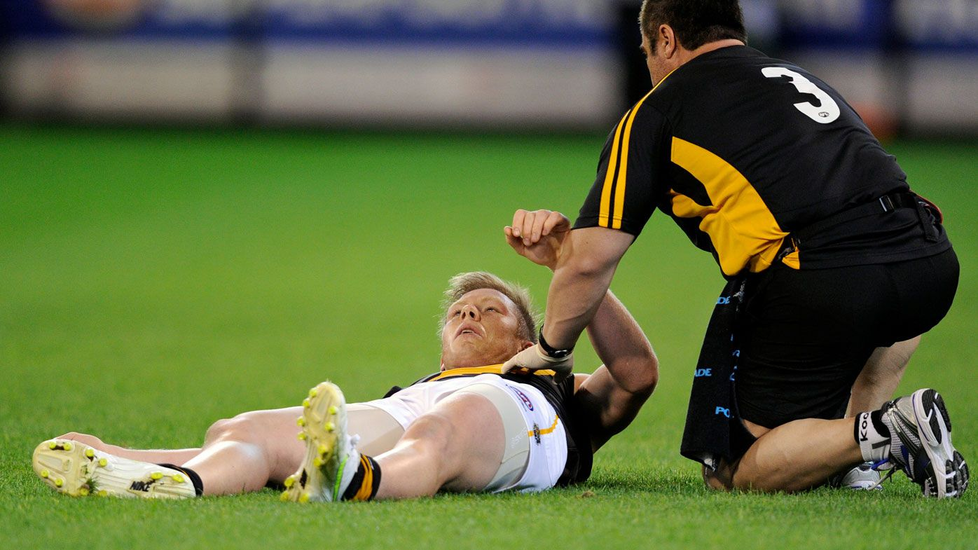 Richmond's Jack Riewoldt lands awkwardly after a mark in a 2011 match