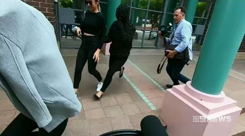 Tina Thanh Truc Phan hid her face as she ran from court after avoiding jail for supplying 390 MDMA pills at a music festuval last year.