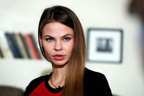 A Belarusian model who claims to have information tying Russia to Donald Trump's election campaign says she has since turned that material over to Russian billionaire businessman Oleg Deripaska.