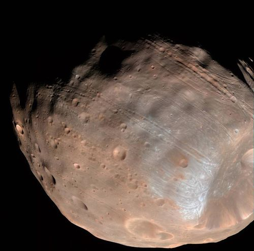 New modeling indicates that the grooves on Mars' moon Phobos could be produced by tidal forces – the mutual gravitational pull of the planet and the moon. Initially, scientists had thought the grooves were created by the massive impact that made Stickney crater (lower right). Image Credit: NASA/JPL-Caltech/University of Arizona