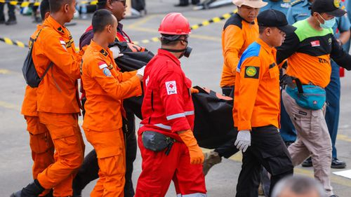 Rescue team members have filled body bags with parts of dismembered passengers.