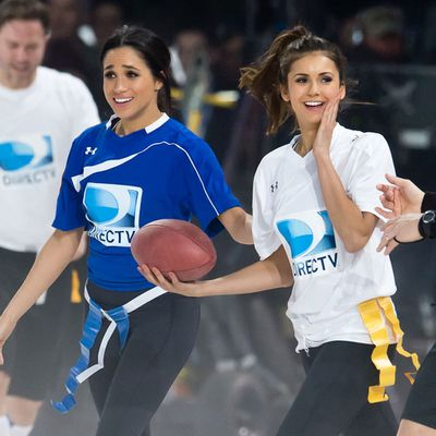 Meghan Markle and Nina Dobrev participate in the Celebrity Beach Bowl, February 2014