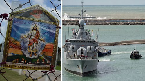 Relatives of the missing crew placed a religious message on the fence of the Mar Del Plata naval base in Argentina. Right: a warship leaves the base to help search for the missing vessel. (Photo: AP).