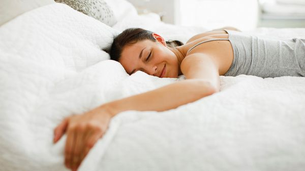 Woman lying on bed.