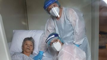 Mrs Manuele two daughters wearing PPE while visiting her during the coronavirus pandemic.