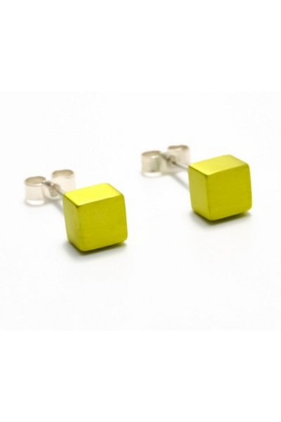"<a href=""https://www.wolfandbadger.com/au/cube-earrings-chartreuse/"" target=""_blank"">Filip Vanas earrings, $99 at WolfAndBadger.com</a>"