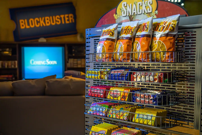 Blockbuster Airbnb movie snacks, featuring Doritos with original '90s packaging