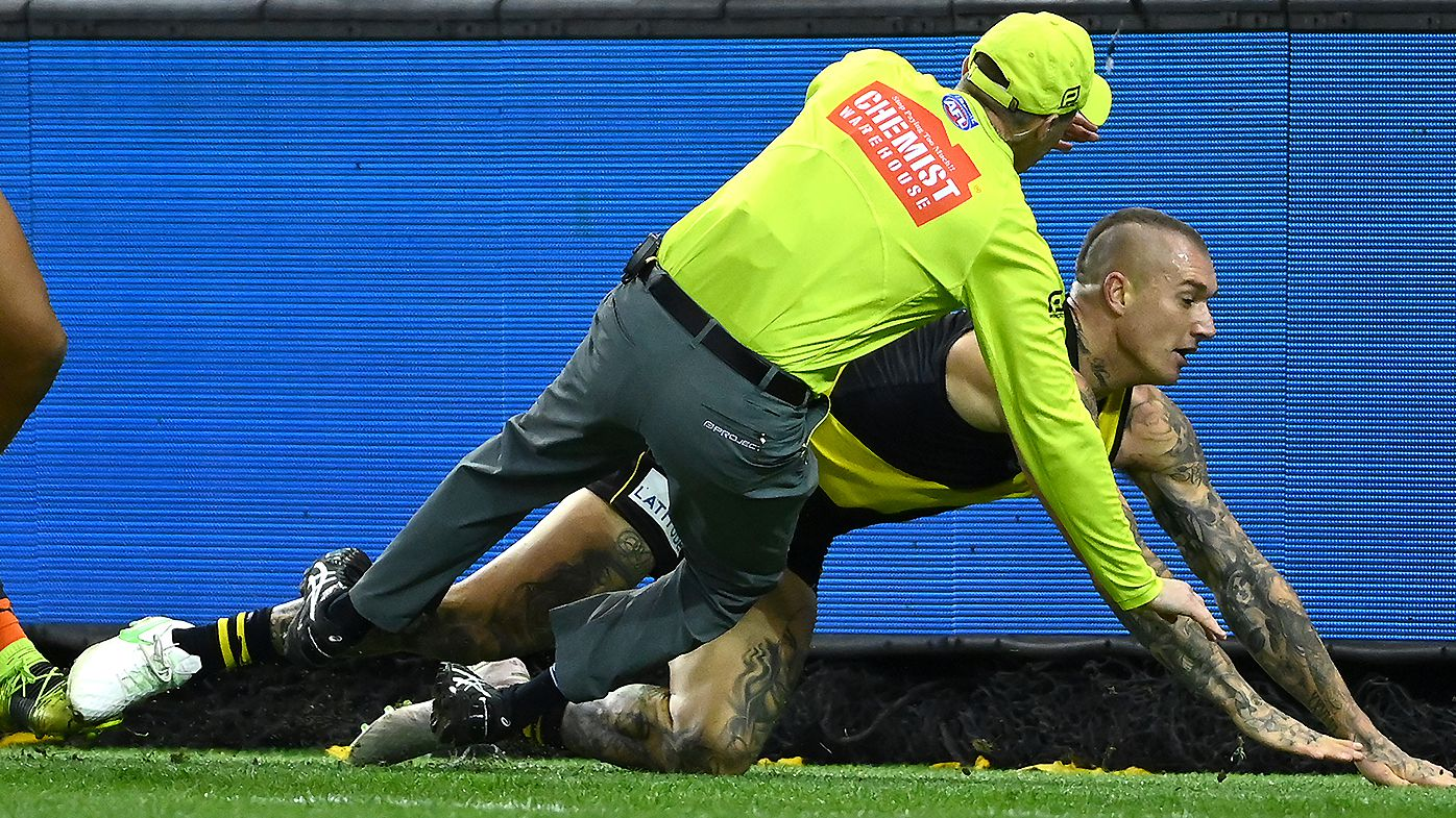 'A bit of carry-on': Dustin Martin's savage response after bulldozing goal umpire in Richmond win