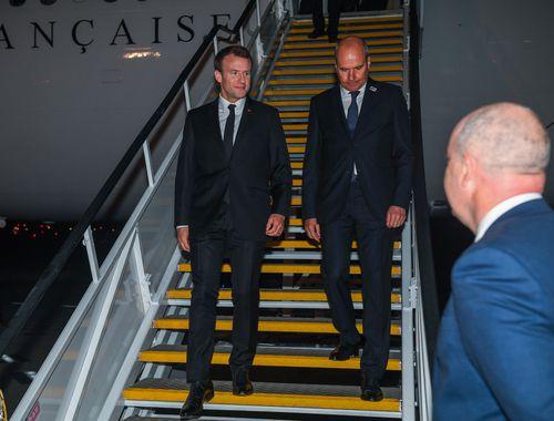 President of France Emmanuel Macron (left) is met by Christophe Penot, the Ambassador of France to Australia, as he arrives in Sydney. (AAP)