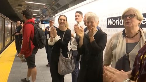 Passengers applaud as the subway finally pulls in at WTC Cortlandt again.