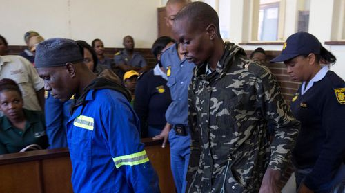 South African 'cannibal case' men get life sentences.