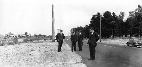 Serial killer Eric Edgar Cooke, second from left, is pictured with WA Police at the crime scene of murder he later confessed to.