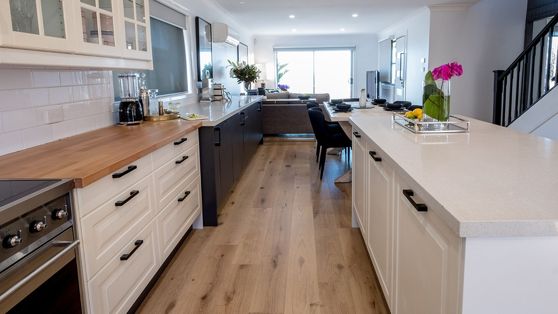 AFTER: The open plan kitchen that opens on the dining and lounge room