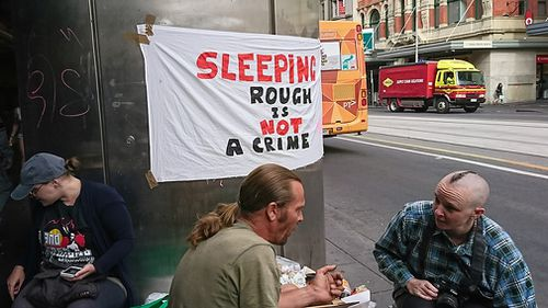 Protesters at a homeless camp outside Flinders Street station before it was cleared out. (AAP)
