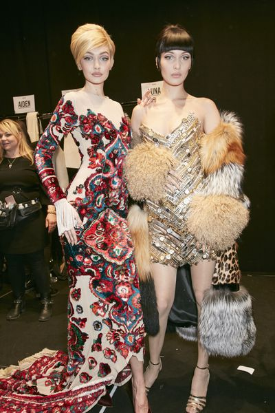 The supermodel sisters are spotted backstage ahead of the Moschino show during Milan Fashion Week Fall/Winter 2017/18 on February 23, 2017 in Milan, Italy. Image: Getty.
