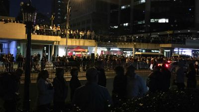 Crowds line Adelaide Street along the Shrine of Remembrance for the dawn service in Brisbane. (AAP)