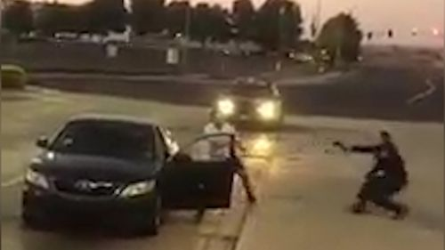 A Californian police officer faces off with a suspect. (Facebook/Jewel Armstrong)