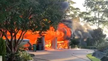 A home goes up in flames in Wamberal on the NSW Central Coast.