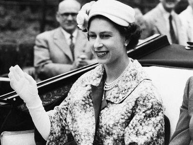 Queen Elizabeth on the way to the races in June 1957.