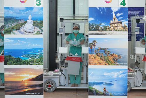 Phuket International Airport staff await incoming travellers on July 1.