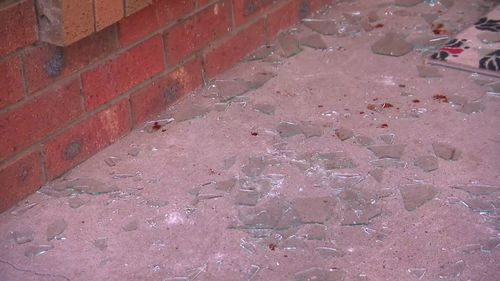 One police officer was injured in the raid. Picture: 9NEWS