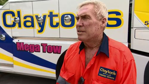 "Tow-truck driver Jim Houlihan said mobile phone drivers were ""impatient, ignorant and stupid""."