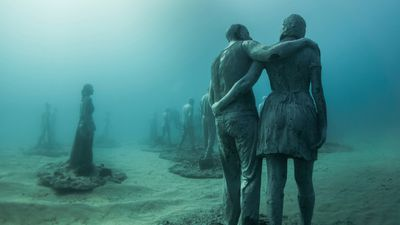 """The main installation, <em>The Rubicon</em> features a group of 35 people walking towards a gate, a point of no return or a portal to another world."" (Jason deCaires Taylor)"