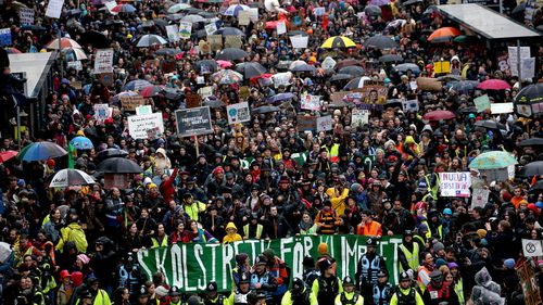 A general view as Greta Thunberg (bottom, yellow coat) takes part the Bristol Youth Strike 4 Climate protest at College Green in Bristol.
