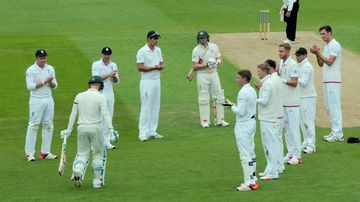 The English cricket team gives Australia captain MIchael Clarke a guard of honour as he walks to the crease at the Oval.