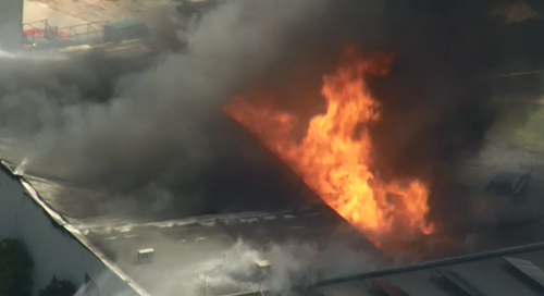 Massive flames issuing from the factory.