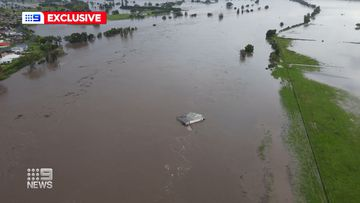 Aerial view of the couple's NSW home taken away in the historic floods.
