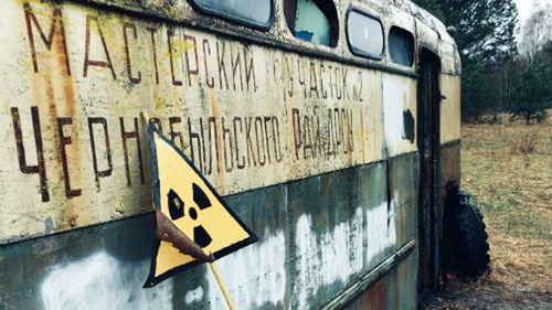 An abandoned bus belonging to the Chernobyl Road Repairing and Building Service.