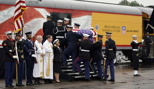 Following the services, a special funeral train was carrying Bush's remains through small towns to the family plot on the presidential library grounds at Texas A&M University in College Station.