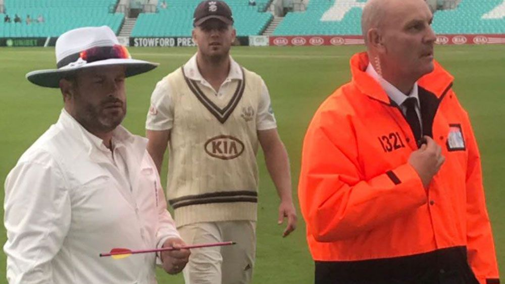 Play has been abandoned at a match in London after an arrow was fired onto the ground.