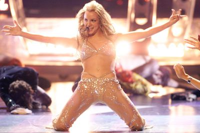 ...and then came the Britney we've all grown to know and love. Sexy, out there, and hot to trot! At the 2000 MTV VMA Awards, Brit shocked the crowd by stripping off to reveal this nude, sequined number. Yeow!