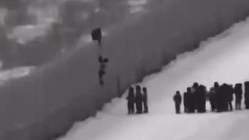 US Customs and Border Protection officials based in Arizona announced that 100 migrants had been taken into custody after being caught on camera scaling a border wall in the US state.