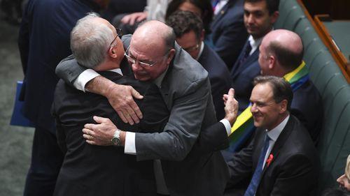 Veteran Liberal MP Warren Entsch hugs the prime minister. (AAP)