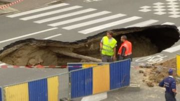 Watch your step: Sinkhole opens up in middle of road