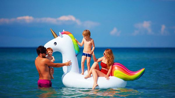 Family on unicorn inflatable
