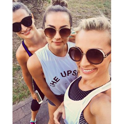 His girlfriend Anna Heinrich took a stroll with her sisters in Bondi the night before...