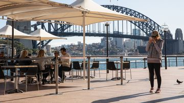 Many owners say it won't be sustainable for them to reopen if they are forced to close for a fortnight whenever a case is linked to the venue. Diners eat at the Portobello Caffe at Circular Quay on June 01, 2020 in Sydney, Australia.
