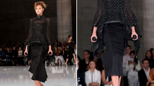 One model carried the 360-degree cameras in her hands as she walked the runway. (Supplied: Couturing)